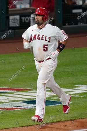 Los Angeles Angels' Albert Pujols (5) runs the bases after hitting a home run during an MLB baseball game against the Chicago White Sox, in Anaheim, Calif