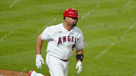 Los Angeles Angels' Albert Pujols (5) runs to first base during an MLB baseball game against the Chicago White Sox, in Anaheim, Calif