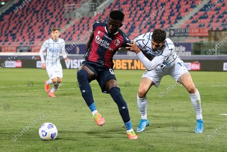 Bologna's Musa Barrow (L) and Inter's Andrea Ranocchia (R) in action during the Italian Serie A soccer match Bologna FC vs FC Inter Milan at Renato Dall'Ara stadium, Bologna, Italy, 03 April 2021.