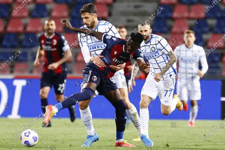 Bologna's Musa Barrow (R) and Inter's   Andrea Ranocchia (2L) in action during the Italian Serie A soccer match Bologna FC vs FC Inter Milan at Renato Dall'Ara stadium, Bologna, Italy, 03 April 2021.