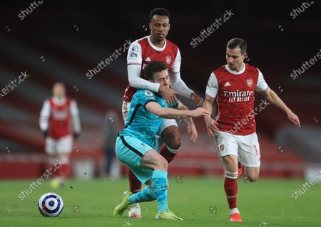 Liverpool's Diogo Jota (C) in action against Arsenal's Gabriel (L) and Cedric Soares (R) during the English Premier League soccer match between Arsenal FC and Liverpool FC in London, Britain, 03 April 2021.