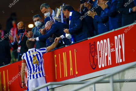 The injured Real Sociedad captain Asier Illarramendi receives the Cup