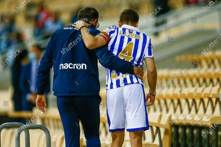 The injured Real Sociedad captain Asier Illarramendi goes to receive the Cup