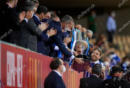 Asier Illarramendi of Real Sociedad celebrates with the trophy during the Copa Del Rey Final match between Real Sociedad and Athletic Club at Estadio de La Cartuja on April 3, 2021 in Seville, Spain. Sporting stadiums around Spain remain under strict restrictions due to the Coronavirus Pandemic as Government social distancing laws prohibit fans inside venues resulting in games being played behind closed doors.