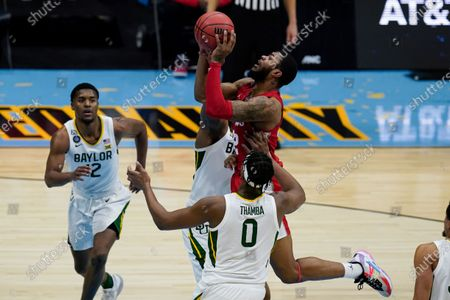 Houston forward Reggie Chaney, top, shoots over Baylor forward Flo Thamba (0) during the second half of a men's Final Four NCAA college basketball tournament semifinal game, at Lucas Oil Stadium in Indianapolis