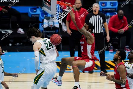 Houston forward Reggie Chaney (32) dunks the ball over Baylor guard Matthew Mayer (24) during the second half of a men's Final Four NCAA college basketball tournament semifinal game, at Lucas Oil Stadium in Indianapolis