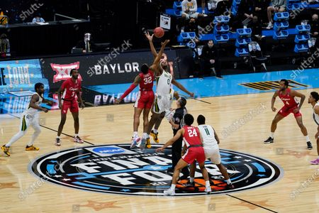 Houston forward Reggie Chaney (32) fights for the opening tipoff with Baylor forward Flo Thamba (0) during the first half of a men's Final Four NCAA college basketball tournament semifinal game, at Lucas Oil Stadium in Indianapolis