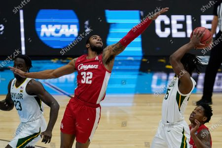 Houston forward Reggie Chaney (32) tries to block a shot by Baylor guard Davion Mitchell (45) during the first half of a men's Final Four NCAA college basketball tournament semifinal game, at Lucas Oil Stadium in Indianapolis