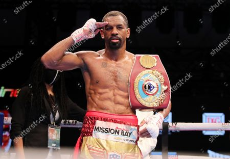 Jamel Herring of the United States celebrates after stopping Britain's Carl Frampton in the sixth round of their WBO super-featherweight world title fight in Dubai, UAE, early