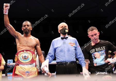 Jamel Herring of the United States, left, celebrates after stopping Britain's Carl Frampton in the sixth round of their WBO super-featherweight world title fight in Dubai, UAE, early
