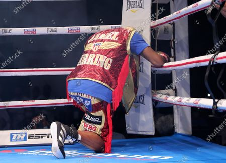 Jamel Herring of the United States prays before his fight against Britain's Carl Frampton in a WBO super-featherweight world title fight in Dubai, UAE, early