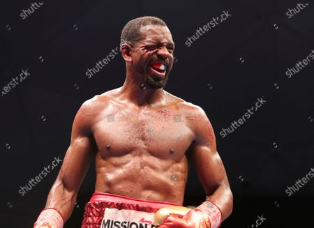 Blood from a cut runs down the face of Jamel Herring of the United States as he fights Britain's Carl Frampton in a WBO super-featherweight world title fight in Dubai, UAE, early