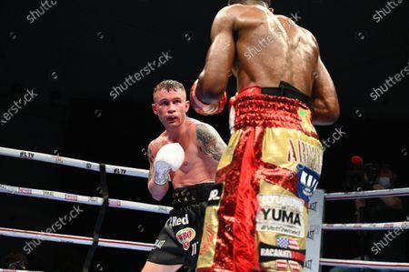 Jamel Herring vs Carl Frampton. Jamel Herring in action against Carl Frampton