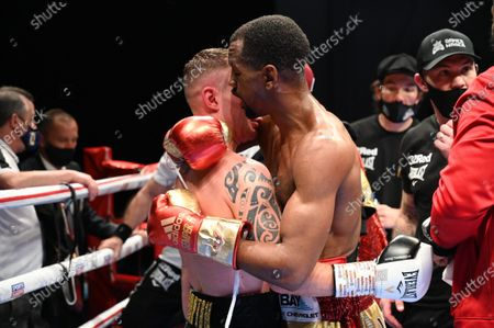 Jamel Herring vs Carl Frampton. Jamel Herring with Carl Frampton after Frampton retired from the bout in the sixth round