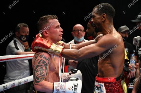 Stock Image of Jamel Herring vs Carl Frampton. Jamel Herring with Carl Frampton after Frampton retired from the bout in the sixth round