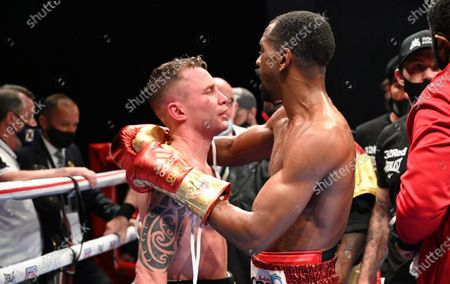 Stock Picture of Jamel Herring vs Carl Frampton. Jamel Herring with Carl Frampton after Frampton retired from the bout in the sixth round
