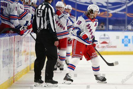 New York Rangers forward Artemi Panarin (10) celebrates his second goal of the night during the second period of an NHL hockey game against the Buffalo Sabres, in Buffalo, N.Y