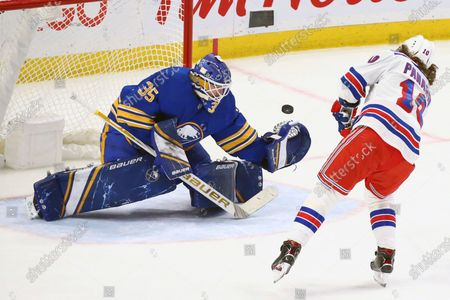 Buffalo Sabres goalie Linus Ullmark (35) stops New York Rangers forward Artemi Panarin (10) during the shootout of an NHL hockey game, in Buffalo, N.Y
