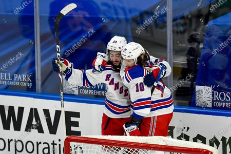New York Rangers center Mika Zibanejad (93) celebrates with left wing Artemi Panarin (10) after scoring the winning goal against the Buffalo Sabres during the overtime period of an NHL hockey game in Buffalo, N.Y., . New York beat Buffalo 3-2