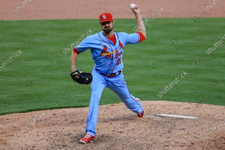 Stock Photo of St. Louis Cardinals' Andrew Miller throws during a baseball game against the Cincinnati Reds in Cincinnati, . The Reds won 9-6