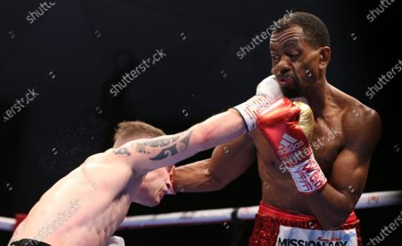 Jamel Herring (R) of the USA in action against Carl Frampton (L) of Northern Ireland during the D4G Promotions' Legacy Fight Night Boxing match in the Gulf emirate of Dubai, United Arab Emirates, 03 April 2021.