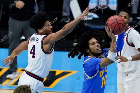 Stock Image of Guard Tyger Campbell (10) shoots ahead of Gonzaga guard Aaron Cook (4) during the second half of a men's Final Four NCAA college basketball tournament semifinal game, at Lucas Oil Stadium in Indianapolis