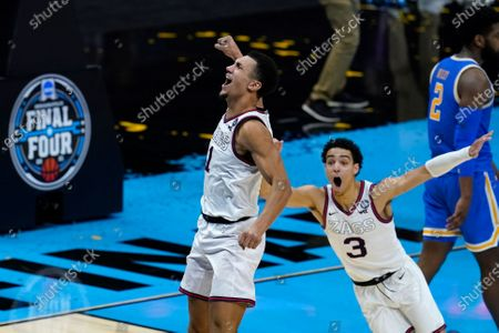 Gonzaga guard Jalen Suggs (1) celebrates making the game winning basket against UCLA during overtime in a men's Final Four NCAA college basketball tournament semifinal game, at Lucas Oil Stadium in Indianapolis. Gonzaga won 93-90