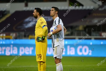 Cristiano Ronaldo of Juventus FC and Salvatore Sirigu waits for the Var Check during the Serie A football match between Torino FC and Juventus. Sporting stadiums around Italy remain under strict restrictions due to the Coronavirus Pandemic as Government social distancing laws prohibit fans inside venues resulting in games being played behind closed doors.  The match ended 2-2