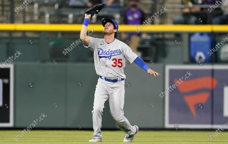 Los Angeles Dodgers center fielder Cody Bellinger pulls in a shallow fly ball off the bat of Colorado Rockies' Chris Owings for the final out in the ninth inning of a baseball game, in Denver