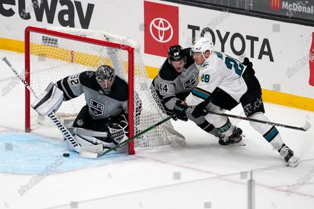 San Jose Sharks right wing Timo Meier, right, tries to get a shot past Los Angeles Kings goaltender Jonathan Quick, left, as defenseman Mikey Anderson defends during the third period of an NHL hockey game, in Los Angeles