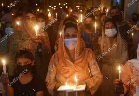 Editorial image of Christian worshipers pray and hold candles during an Easter vigil mass at Don Bosco Church, Lahore, Punjab, Pakistan - 03 Apr 2021