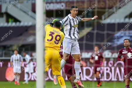 Salvatore Sirigu of Torino FC and Cristiano Ronaldo of Juventus FC during the Serie A football match between Torino FC and Juventus FC at Olympic Grande Torino Stadium on April 03, 2021 in Turin, Italy. Final result: 2-2