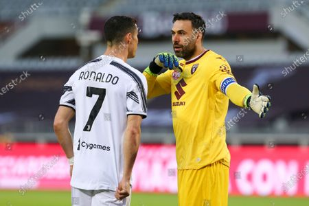 Cristiano Ronaldo of Juventus FC and Salvatore Sirigu of Torino FC during the Serie A football match between Torino FC and Juventus FC at Olympic Grande Torino Stadium on April 03, 2021 in Turin, Italy. Final result: 2-2