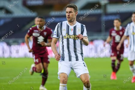 Stock Photo of Aaron Ramsey of Juventus FC  during the Serie A football match between Torino FC and Juventus FC at Olympic Grande Torino Stadium on April 03, 2021 in Turin, Italy. 