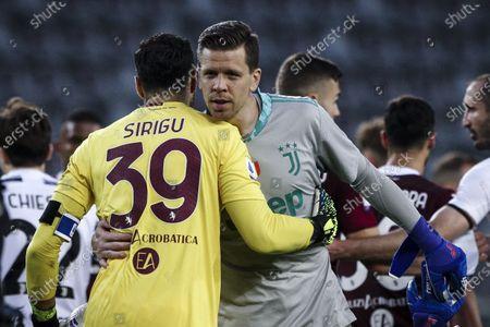 Torino goalkeeper Salvatore Sirigu (39) hugs Juventus goalkeeper Wojciech Szczesny (1) after the Serie A football match n.29 TORINO - JUVENTUS on April 03, 2021 at the Stadio Olimpico Grande Torino in Turin, Piedmont, Italy. Final result: Torino-Juventus 2-2.
