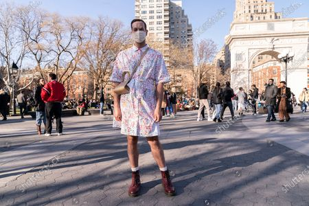New Yorkers enjoy sunny spring Saturday in Washington Square and Tompkins Square Parks. On this image a man wearing dress by designer Rachel Antonoff poses for the camera.