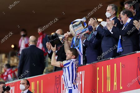 Asier Illarramendi of Real Sociedad receive the trophy after the Copa Del Rey Final match between Real Sociedad and Athletic Club at Estadio de La Cartuja in Sevilla, Spain on April 3, 2021. Sporting stadiums around Spain remain under strict restrictions due to the Coronavirus Pandemic as Government social distancing laws prohibit fans inside venues resulting in games being played behind closed doors.