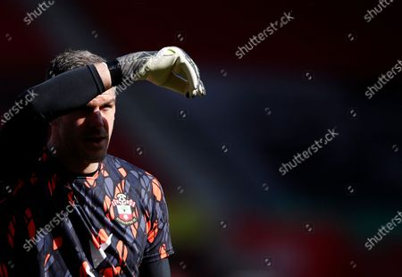 Southampton's goalkeeper Fraser Forster looks on during warm up before the English Premier League soccer match between Southampton and Burnley at St. Mary's Stadium in Southampton, England