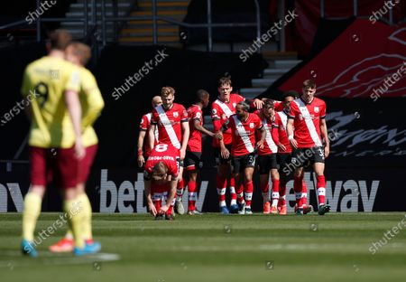 Southampton's Danny Ings celebrates with teammates after scoring his side's second goal during the English Premier League soccer match between Southampton and Burnley at St. Mary's Stadium in Southampton, England