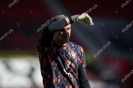 Goalkeeper Fraser Forster of Southampton warms up ahead of the English Premier League soccer match between Southampton FC and Burnley FC in Southampton, Britain, 04 April 2021.