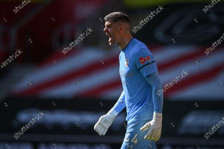 Goalkeeper Fraser Forster of Southampton reacts during the English Premier League soccer match between Southampton FC and Burnley FC in Southampton, Britain, 04 April 2021.
