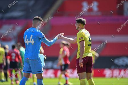 Goalkeeper Fraser Forster (L) of Southampton congratulates James Tarkowski (R) of Burnley after the English Premier League soccer match between Southampton FC and Burnley FC in Southampton, Britain, 04 April 2021.
