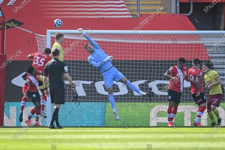 Goalkeeper Fraser Forster (C) of Southampton makes a save during the English Premier League soccer match between Southampton FC and Burnley FC in Southampton, Britain, 04 April 2021.