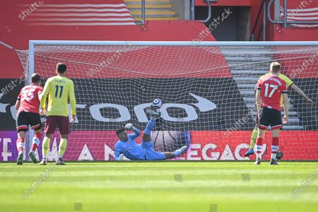Goalkeeper Fraser Forster (C) of Southampton concedes a goal from Chris Wood (not pictured) during the English Premier League soccer match between Southampton FC and Burnley FC in Southampton, Britain, 04 April 2021.