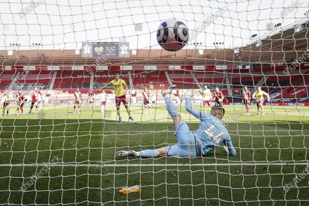 Chris Wood (L) of Burnley scores a goal from the penalty spot past goalkeeper Fraser Forster (R) of Southampton during the English Premier League soccer match between Southampton FC and Burnley FC in Southampton, Britain, 04 April 2021.