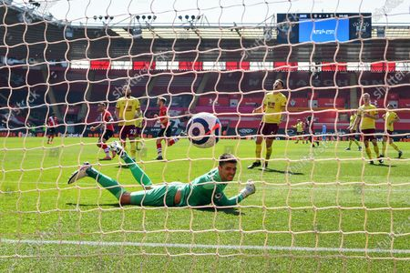 Stuart Armstrong (not pictured) of Southampton scores a goal past goalkeeper Nick Pope (down) of Burnley during the English Premier League soccer match between Southampton FC and Burnley FC in Southampton, Britain, 04 April 2021.