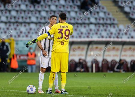 Cristiano Ronaldo of Juventus FC talks to Salvatore Sirigu of Torino FC
