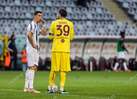 Stock Photo of Cristiano Ronaldo of Juventus FC talks to Salvatore Sirigu of Torino FC