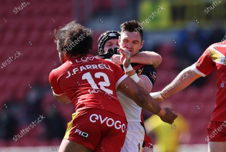 Stock Picture of Bradford Bulls' Danny Brough in action with Sheffield Eagles' Joel Farrell and Greg Burns