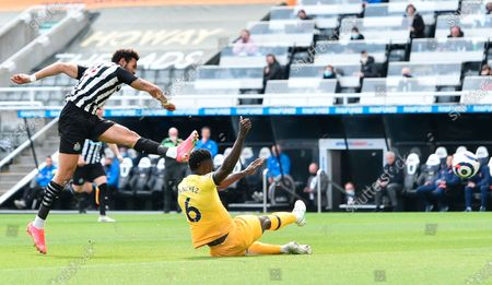 Newcastle's Joelinton (L), tackled by Tottenham's Davinson Sanchez (down) during the English Premier League soccer match between Newcastle United and Tottenham Hotspur in Newcastle, Britain, 04 April 2021.